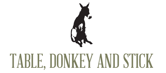 annual--un-dinner-table-donkey-stick